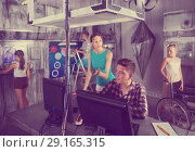 Купить «Parents with kids are solving puzzles on computer», фото № 29165315, снято 3 августа 2017 г. (c) Яков Филимонов / Фотобанк Лори