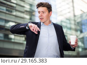 Купить «Portrait of busy man rushing to important meeting», фото № 29165383, снято 20 апреля 2017 г. (c) Яков Филимонов / Фотобанк Лори