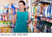 Купить «Woman choosing detergent for washing», фото № 29165567, снято 6 июня 2017 г. (c) Яков Филимонов / Фотобанк Лори