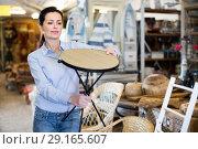 Купить «Woman customer choosing chair before buying», фото № 29165607, снято 22 ноября 2017 г. (c) Яков Филимонов / Фотобанк Лори