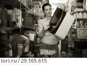 Купить «Smiling woman choosing purpose basket», фото № 29165615, снято 22 ноября 2017 г. (c) Яков Филимонов / Фотобанк Лори