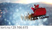 Купить «Composite image of santa claus riding on sleigh with gift box», фото № 29166615, снято 8 июля 2020 г. (c) Wavebreak Media / Фотобанк Лори