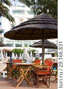 Купить «Empty street cafe in Constantinou Bros Athena Beach Hotel. The hotel was fully refurbished in the winter of 10/11», фото № 29166831, снято 20 июля 2017 г. (c) Papoyan Irina / Фотобанк Лори