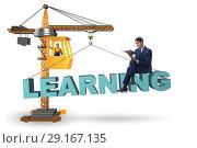 Купить «Young student in learning and education concept», фото № 29167135, снято 19 июня 2019 г. (c) Elnur / Фотобанк Лори