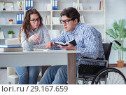 Купить «Disabled student studying and preparing for college exams», фото № 29167659, снято 12 апреля 2017 г. (c) Elnur / Фотобанк Лори