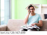 Купить «Student preparing for university exams at home», фото № 29167699, снято 19 мая 2018 г. (c) Elnur / Фотобанк Лори