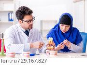 Купить «Dentist doctor and assistant working on new tooth implant», фото № 29167827, снято 24 апреля 2018 г. (c) Elnur / Фотобанк Лори