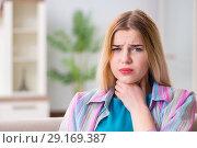 Купить «Young woman suffering from sore throat pain», фото № 29169387, снято 30 марта 2018 г. (c) Elnur / Фотобанк Лори