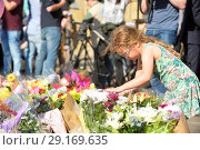 Купить «Tributes in St Anne's Square in Manchester for the victims of the terror attack at the Ariana Grande concert Featuring: Atmosphere Where: Manchester, United...», фото № 29169635, снято 24 мая 2017 г. (c) age Fotostock / Фотобанк Лори