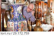 Купить «male looking at antique oriental vase», фото № 29172759, снято 15 мая 2018 г. (c) Яков Филимонов / Фотобанк Лори
