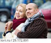 Купить «Portrait of positive pleasant smiling mature couple in city», фото № 29172891, снято 18 октября 2018 г. (c) Яков Филимонов / Фотобанк Лори