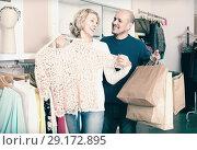 Купить «Elderly spouses buying new blouse in boutique», фото № 29172895, снято 19 октября 2018 г. (c) Яков Филимонов / Фотобанк Лори