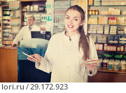 Купить «Smiling pleasant female pharmacist posing», фото № 29172923, снято 14 ноября 2018 г. (c) Яков Филимонов / Фотобанк Лори