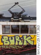 Купить «A grafitti covered, yellow Bica Funicular electric train at the upper terminus of the Elavador da Bica, on Calcada da Gloria Street, Sao Paulo, Lisbon, Lisboa, Portugal.», фото № 29177363, снято 17 февраля 2020 г. (c) age Fotostock / Фотобанк Лори