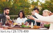 Купить «friends eating and sharing food at rooftop party», видеоролик № 29179499, снято 26 сентября 2018 г. (c) Syda Productions / Фотобанк Лори
