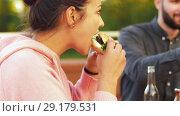 Купить «friends eating burgers at rooftop party», видеоролик № 29179531, снято 26 сентября 2018 г. (c) Syda Productions / Фотобанк Лори