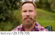 Купить «portrait of happy smiling man with beard», видеоролик № 29179735, снято 4 октября 2018 г. (c) Syda Productions / Фотобанк Лори