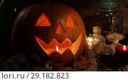 Купить «Halloween pumpkin head jack lantern with burning candles. Halloween holidays art design, celebration», видеоролик № 29182823, снято 5 октября 2018 г. (c) Алексей Кузнецов / Фотобанк Лори