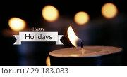 Happy Holidays text and lit candles 4k. Стоковое видео, агентство Wavebreak Media / Фотобанк Лори
