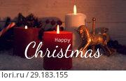 Lit Christmas candles and decoration 4k. Стоковое видео, агентство Wavebreak Media / Фотобанк Лори