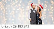 Купить «happy couple in santa hats at christmas party», фото № 29183843, снято 15 декабря 2017 г. (c) Syda Productions / Фотобанк Лори