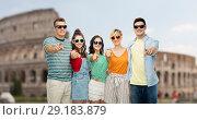Купить «friends in shades pointing at you over coliseum», фото № 29183879, снято 30 июня 2018 г. (c) Syda Productions / Фотобанк Лори