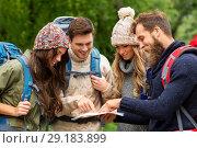 Купить «friends or travelers hiking with backpacks and map», фото № 29183899, снято 31 августа 2014 г. (c) Syda Productions / Фотобанк Лори