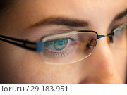 Купить «close up of woman in glasses looking at screen», фото № 29183951, снято 3 января 2018 г. (c) Syda Productions / Фотобанк Лори