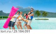 Купить «friends with beach accessories over bora bora», фото № 29184091, снято 30 июня 2018 г. (c) Syda Productions / Фотобанк Лори