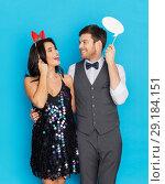 Купить «happy couple with party props having fun», фото № 29184151, снято 15 декабря 2017 г. (c) Syda Productions / Фотобанк Лори