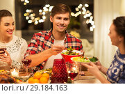 Купить «happy friends having christmas dinner at home», фото № 29184163, снято 17 декабря 2017 г. (c) Syda Productions / Фотобанк Лори