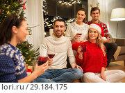 Купить «friends celebrating christmas and drinking wine», фото № 29184175, снято 17 декабря 2017 г. (c) Syda Productions / Фотобанк Лори