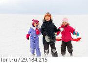 Купить «happy little kids playing outdoors in winter», фото № 29184215, снято 10 февраля 2018 г. (c) Syda Productions / Фотобанк Лори