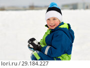 happy little boy playing with snow in winter. Стоковое фото, фотограф Syda Productions / Фотобанк Лори