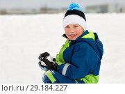 Купить «happy little boy playing with snow in winter», фото № 29184227, снято 10 февраля 2018 г. (c) Syda Productions / Фотобанк Лори
