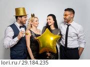 Купить «happy friends with golden party props posing», фото № 29184235, снято 3 марта 2018 г. (c) Syda Productions / Фотобанк Лори