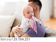 Купить «father with little baby girl at home», фото № 29184251, снято 16 мая 2018 г. (c) Syda Productions / Фотобанк Лори