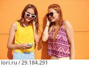 Купить «teenage girls listening to music from smartphone», фото № 29184291, снято 19 июля 2018 г. (c) Syda Productions / Фотобанк Лори