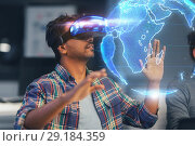 Купить «man in vr headset with earth hologram at office», фото № 29184359, снято 24 января 2018 г. (c) Syda Productions / Фотобанк Лори