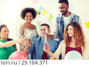 Купить «happy team with drinks celebrating at office party», фото № 29184371, снято 3 сентября 2017 г. (c) Syda Productions / Фотобанк Лори