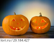 Купить «close up of halloween pumpkins on table», фото № 29184427, снято 17 сентября 2014 г. (c) Syda Productions / Фотобанк Лори