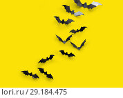 Купить «black halloween bats on yellow background», фото № 29184475, снято 6 июля 2017 г. (c) Syda Productions / Фотобанк Лори