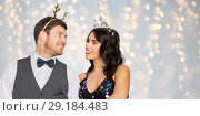 Купить «couple with christmas or new year party props», фото № 29184483, снято 15 декабря 2017 г. (c) Syda Productions / Фотобанк Лори