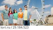 Купить «friends in sunglasses over ferry wheel in london», фото № 29184523, снято 30 июня 2018 г. (c) Syda Productions / Фотобанк Лори