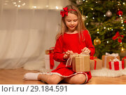 Купить «smiling girl with christmas gift at home», фото № 29184591, снято 22 декабря 2017 г. (c) Syda Productions / Фотобанк Лори