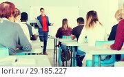 Купить «Male teacher lecturing to students», фото № 29185227, снято 8 мая 2018 г. (c) Яков Филимонов / Фотобанк Лори