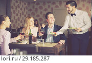 Купить «waiter bringing ordered dishes to guests», фото № 29185287, снято 8 января 2018 г. (c) Яков Филимонов / Фотобанк Лори