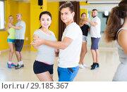 Купить «Positive men and women are dancing waltz in pairs», фото № 29185367, снято 21 июня 2017 г. (c) Яков Филимонов / Фотобанк Лори