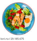 Купить «Image of plate with fried trout, egg, vegetables and green lettuce», фото № 29185675, снято 22 октября 2018 г. (c) Яков Филимонов / Фотобанк Лори