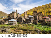 Купить «Ushguli village and typical defensive towers, Upper Svaneti, Georgia», фото № 29186635, снято 28 сентября 2018 г. (c) Юлия Бабкина / Фотобанк Лори